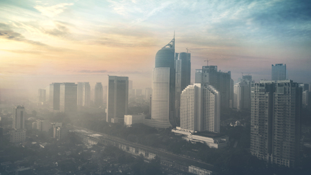 Bird view of Jakarta city with skyscrapers and residential houses on sunrise time