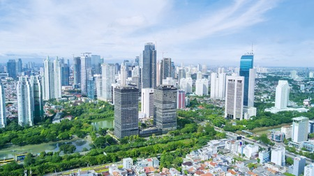 suburban neighborhood: JAKARTA, Indonesia. May 12, 2017:  beautiful skyscrapers with blue sky in the Central Jakarta