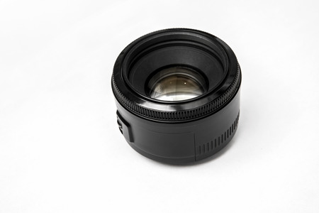 shutter aperture: Close up of a black camera lens on the desk, isolated on white background Stock Photo