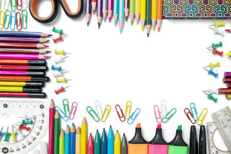 Frame made of multicolored pencils and school supplies with copy space, isolated on white background Stock Photo