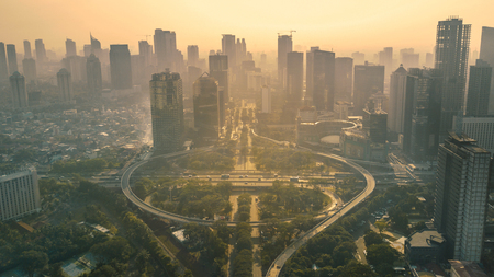 JAKARTA, Indonesia. May 12, 2017: Aerial view of the road junction and interchange overpass in downtown at sunset time