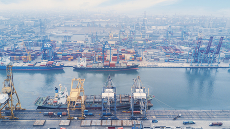 delivery truck: JAKARTA, Indonesia. July 10, 2017: Aerial view of container ship berthing at industrial port