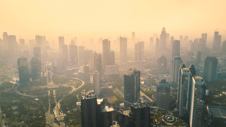 Aerial view of skyscrapers in the downtown Jakarta. Shot at misty morning