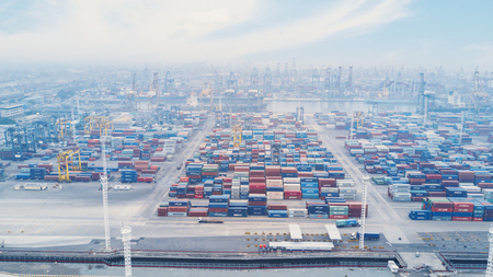 JAKARTA, Indonesia. July 10, 2017: Aerial view of industrial port of Tanjung Priok with crane and stacks of containers