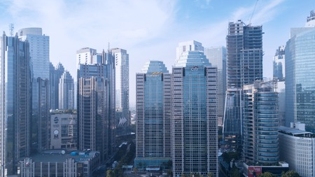 JAKARTA, Indonesia. July 10, 2017: Aerial view of modern skyscrapers of apartment, office bank, hotel, and office buildings in Jakarta Éditoriale