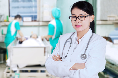 Portrait of female doctor looks confident while standing in hospital photo