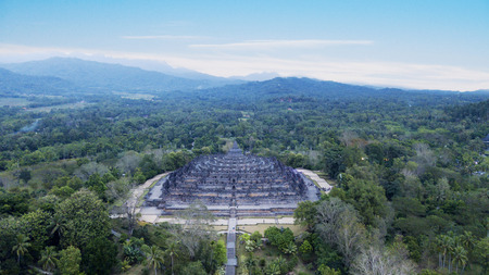 Aerial view of beautiful Borobudur temple under blue sky at Yogyakarta, Indonesia