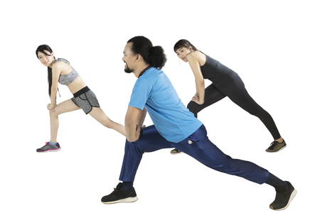 Multicultural of young friends doing stretching exercise together, isolated on white background