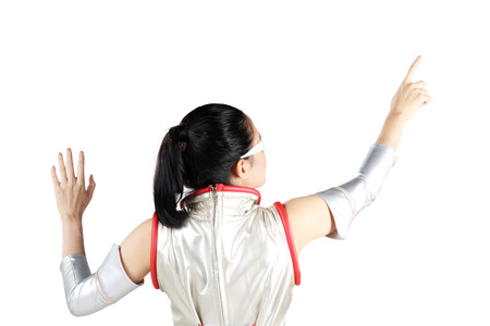 Back view of young woman wearing a futuristic costume while touching something on the whiteboard Stock Photo