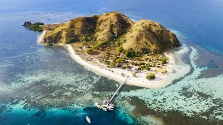 Aerial view of beautiful Kanawa island with turquoise water in East Nusa Tenggara, Indonesia
