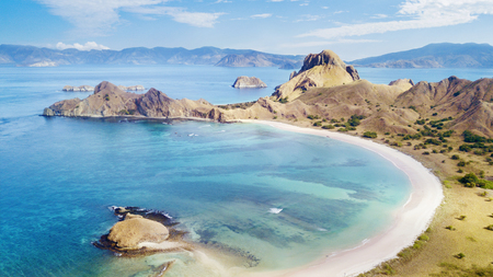 Bird view of Padar island looks amazing under blue skies in East Nusa Tenggara, Indonesia