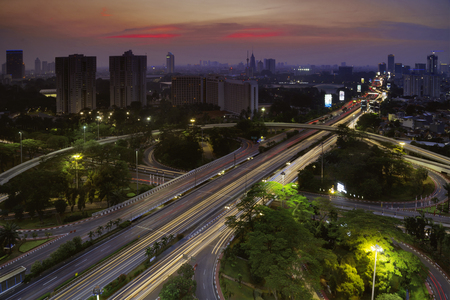 curve road: Aerial view of beautiful Semanggi highway junction with skyscraper in Jakarta, Indonesia Stock Photo