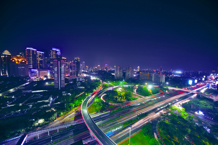 Aerial view of a beautiful downtown with interchange overpass in the night. shot in Jakarta, Indonesia