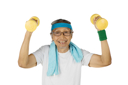 lift hands: Photo of old man smiling at the camera while lifting two dumbbells in his hands, isolated on white background Stock Photo