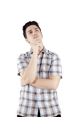 Portrait of a middle eastern male wearing casual clothes while thinking something, isolated on white background
