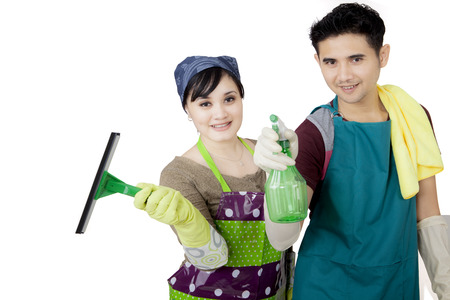 Image of Asian couple cleaning a mirror with a spray and squeegee, isolated on white background Stock Photo