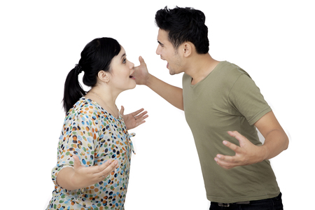 Image of an Asian couple shouting each other while having a quarrel, isolated on white background