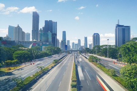 JAKARTA, Indonesia. September 06, 2017: busy highway and office building in the downtown Stok Fotoğraf