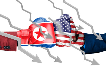 Two hands wearing boxing gloves with North Korea and USA flag. arrows move down, isolated on white background Stock Photo