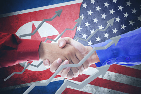 Closeup of two hands businessmen shaking hands, upward arrows with North Korea and USA flag in the background Stock Photo