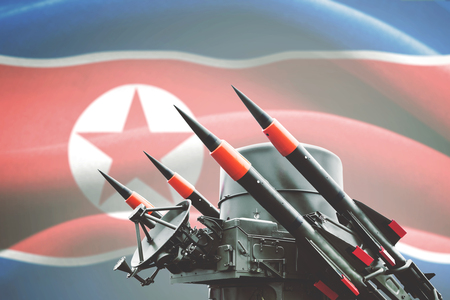 Picture of nuclear weapon for mass destruction with North Korea flag in the background