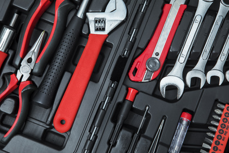 Top view of monkey wrench with with workshop tools in the toolbox Stock Photo
