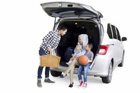 Picture of Muslim family preparing for a road trip while travelling for holiday, isolated on white background