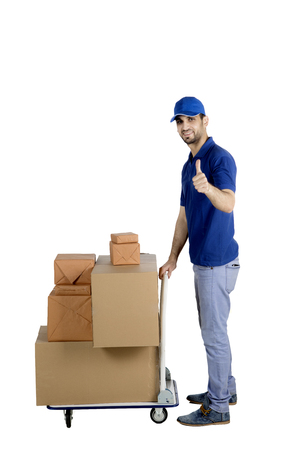 Italian postman showing a thumb up while holding a trolley of packages, isolated on white background