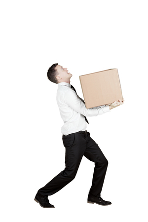 Portrait of a European businessman carrying a box in the studio, isolated on white background Stock Photo