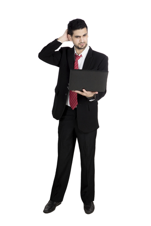 Portrait of Italian businessman having a trouble while working with a computer laptop, isolated on white background