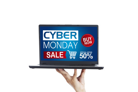 Picture of unknown persons hand showing a computer laptop with Cyber Monday Sale text, isolated on white background
