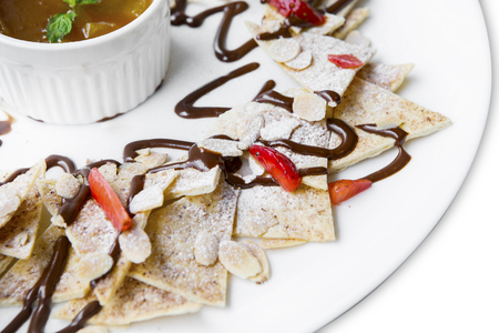 blini: Image of yummy pancake with slice fresh strawberry and chocolate on the plate Stock Photo