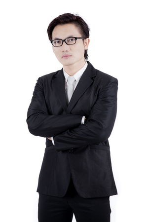 Image of Asian male manager looks confident while standing in the studio, isolated on white background Banque d'images