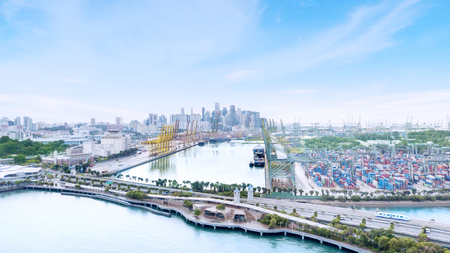 Singapore. November 06, 2017: Beautiful aerial view of Singapore container harbour at daytime with blue sky and downtown background