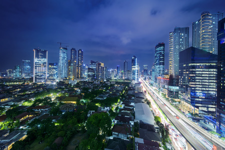 Aerial Jakarta cityscape in Kuningan Central Business District at night
