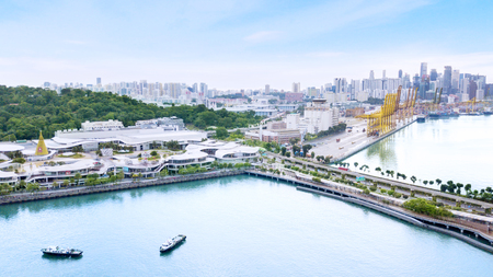 Singapore. November 06, 2017: Drone view of VivoCity Shopping mall and Singapore port with downtown background