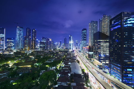 JAKARTA, Indonesia. November 06, 2017: Beautiful cityscape of Kuningan CBD Jakarta at night with flyover, skyscrapers, and colorful light
