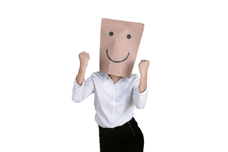 Portrait of unknown businesswoman expressing her success with a paper bag on her head, isolated on white background