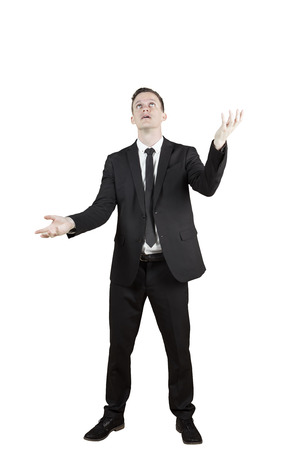 Young Caucasian businessman standing in the studio with juggling pose, isolated on white background