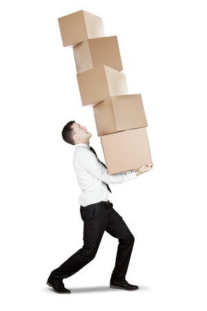 Image of European businessman carrying a pile of boxes in the studio, isolated on white background