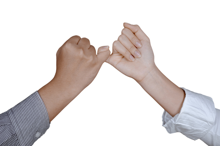 Hands of two business people making a pinkie promise, isolated white background