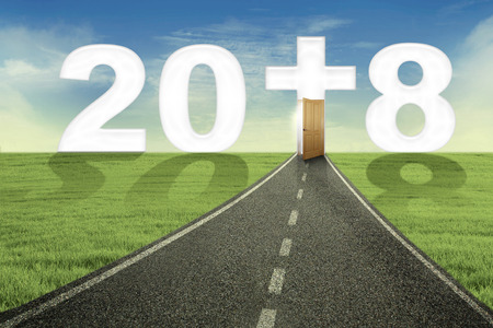 Image of empty road toward a door and number 2018 with a cross symbol