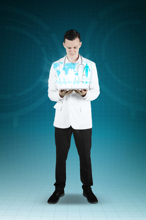 Male Caucasian Doctor Showing A Digital Tablet And Medical Symbol