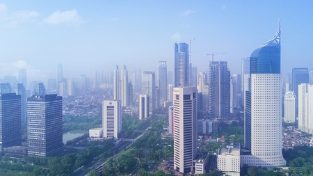 JAKARTA - Indonesia. December 26, 2017: Aerial view of skyscrapers in the Jakarta downtown in misty morning