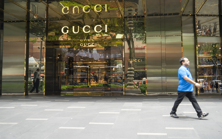 Singapore - January 04, 2018: Portrait of GUCCI store at Orchard road Singapore with visitor Editorial
