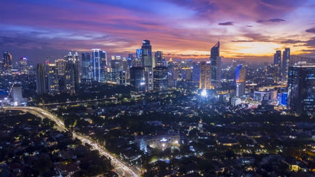 Jakarta, Indonesia. February 09, 2018: beautiful nightfall sky above office building in downtown