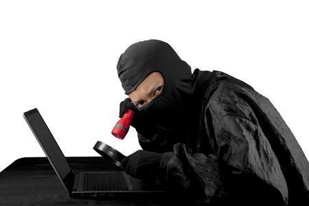 Internet security concept: Hacker using flash light and magnifying glass. Isolated over white background