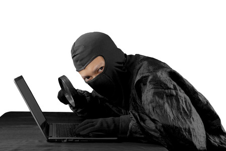 Internet security concept: Hacker trying to crack password using magnifying glass. Isolated over white background