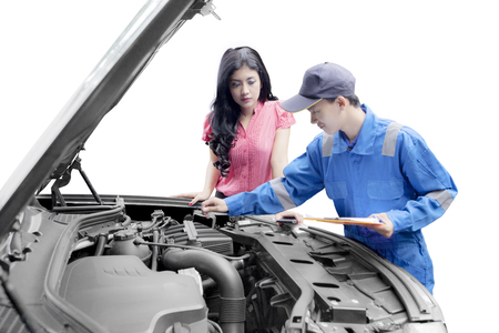 Mechanic helping a customer fixing a car isolated over white background