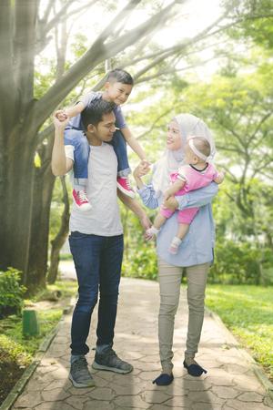 Medium shot of asian muslim family spending summer together 스톡 콘텐츠